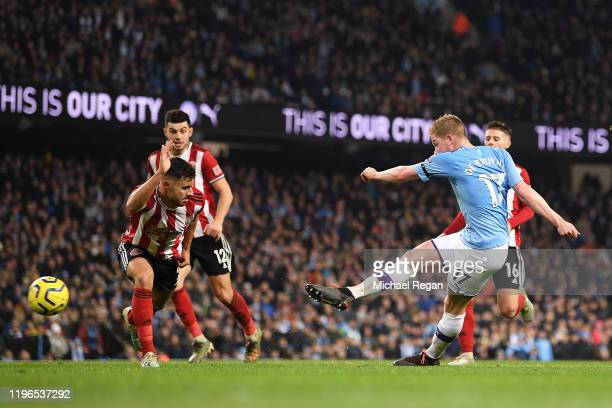 Kevin De Bruyne of Manchester City scores his sides second goal during the Premier League match between Manchester City and Sheffield United at...