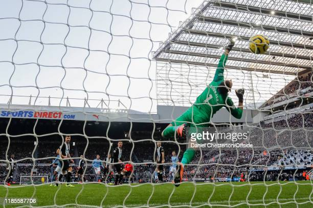 Kevin De Bruyne of Manchester City scores his side's second goal to make the score 1-2 during the Premier League match between Newcastle United and...