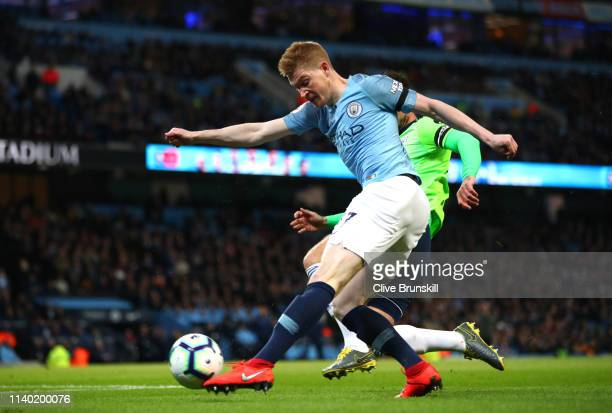 Kevin De Bruyne of Manchester City scores his team's first goal during the Premier League match between Manchester City and Cardiff City at Etihad...