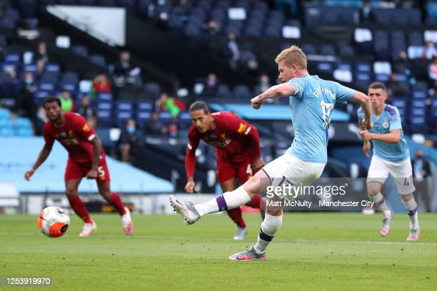Kevin De Bruyne of Manchester City scores his team's first goal from the penalty spot during the Premier League match between Manchester City and...