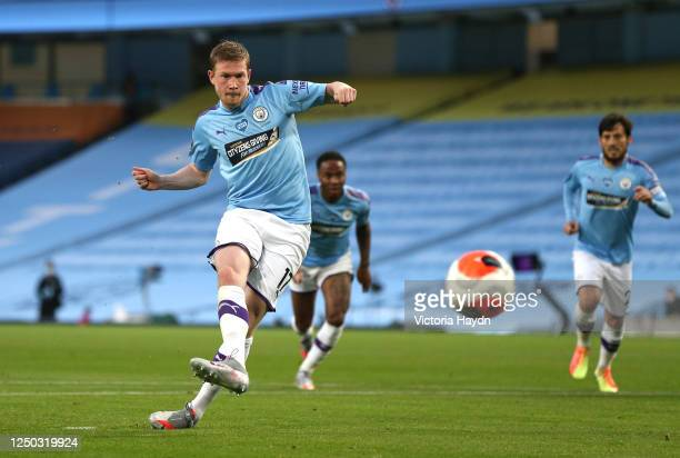 Kevin De Bruyne of Manchester City scores his team's second goal from the penalty spot during the Premier League match between Manchester City and...