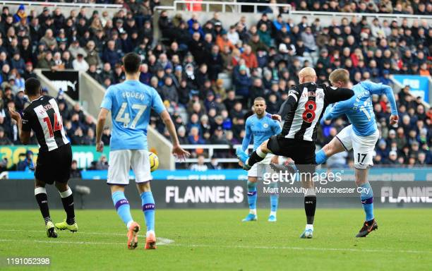 Kevin De Bruyne of Manchester City scores his team's second goal past Jonjo Shelvey of Newcastle United during the Premier League match between...