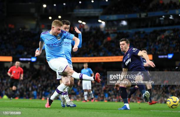 Kevin De Bruyne of Manchester City scores his team's second goal during the Premier League match between Manchester City and West Ham United at...