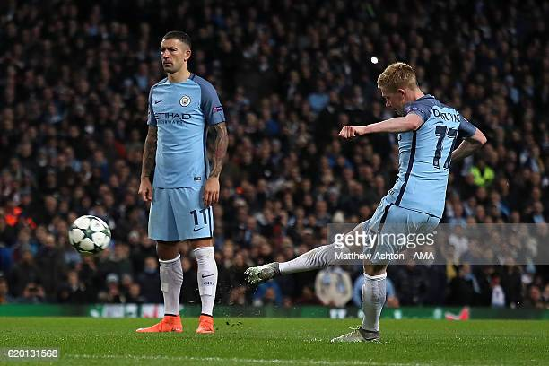 Kevin de Bruyne of Manchester City scores his team's second goal to make the score 21 during the UEFA Champions League match between Manchester City...