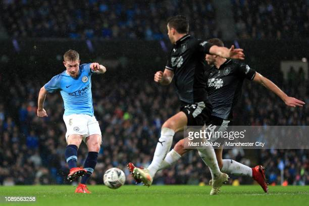 Kevin De Bruyne of Manchester City scores his team's third goal during the FA Cup Fourth Round match between Manchester City and Burnley at Etihad...