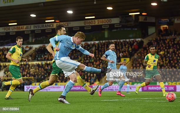 Kevin de Bruyne of Manchester City scores his team's third goal during the Emirates FA Cup third round match between Norwich City and Manchester City...