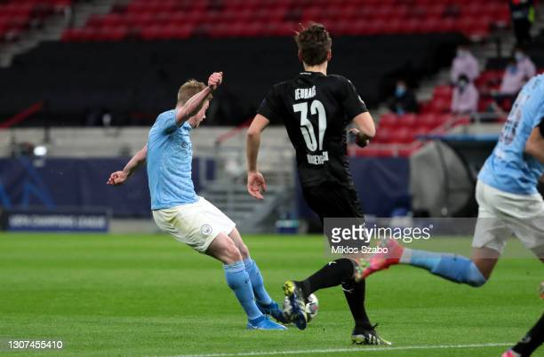 Kevin De Bruyne of Manchester City scores their side's first goal during the UEFA Champions League Round of 16 match between Manchester City and...
