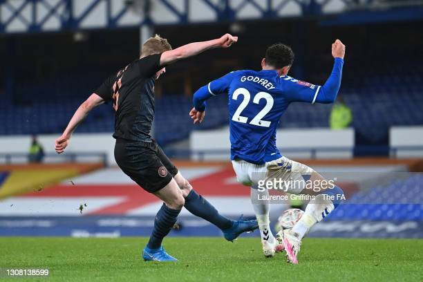 Kevin De Bruyne of Manchester City scores their team's second goal under pressure from Ben Godfrey of Everton during The Emirates FA Cup Quarter...