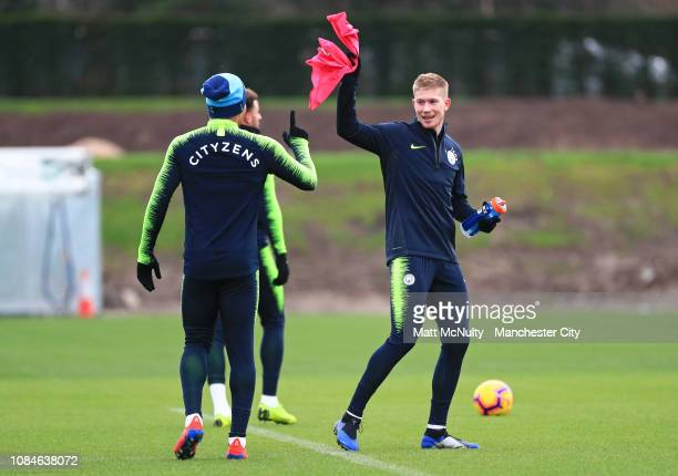 Kevin de Bruyne of Manchester City shares a joke with Gabriel Jesus during the training session at Manchester City Football Academy on January 18...