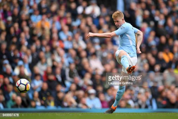 Kevin De Bruyne of Manchester City shoots and scores his side's third goal during the Premier League match between Manchester City and Swansea City...