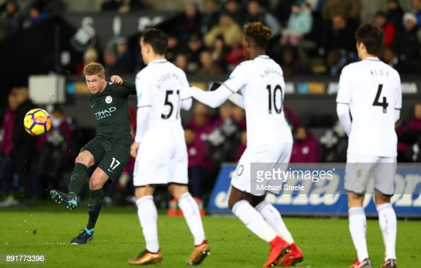 Kevin De Bruyne of Manchester City shoots during the Premier League match between Swansea City and Manchester City at Liberty Stadium on December 13...