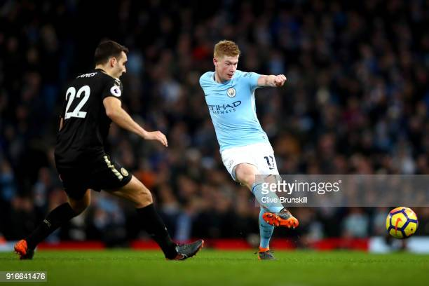 Kevin De Bruyne of Manchester City shoots while under pressure from Matty James of Leicester City during the Premier League match between Manchester...
