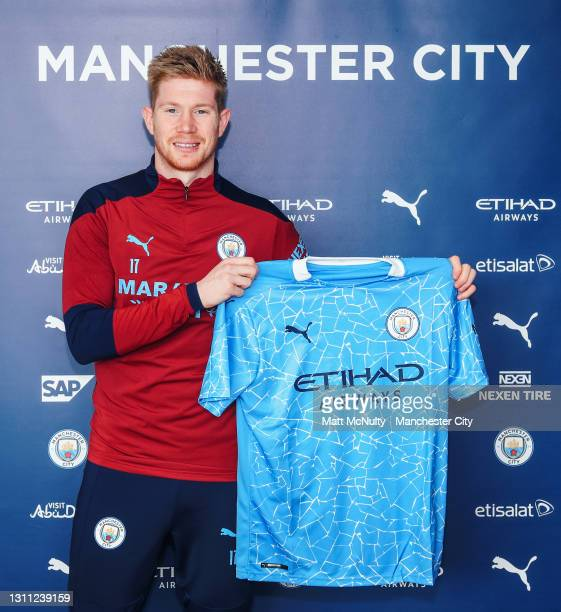 Kevin de Bruyne of Manchester City signs a new contract extension at the club at Manchester City Football Academy on April 07, 2021 in Manchester,...
