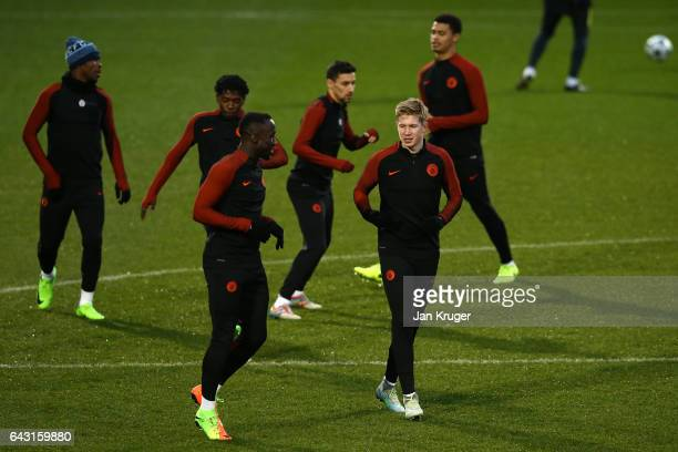Kevin De Bruyne of Manchester City speaks with Bacary Sagna of Manchester City during a Manchester City training session and press conference ahead...