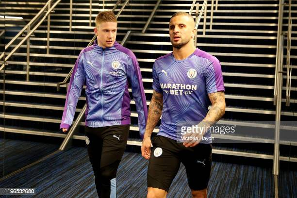 Kevin De Bruyne of Manchester City speaks with Kyle Walker of Manchester City as they walk through the tunnel to warm up ahead of the Premier League...