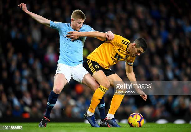 Kevin de Bruyne of Manchester City tackles Conor Coady of Wolverhampton Wanderers during the Premier League match between Manchester City and...