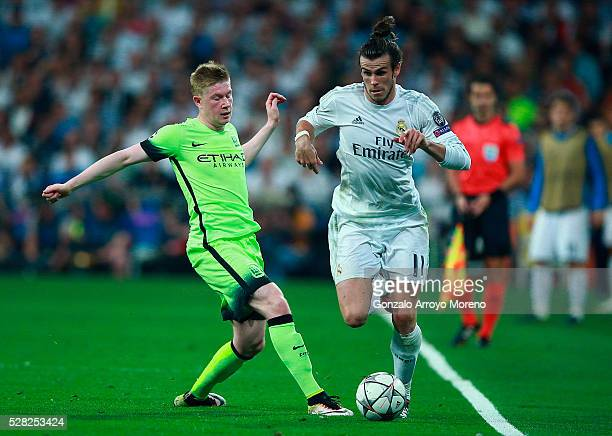 Kevin de Bruyne of Manchester City tackles Gareth Bale of Real Madrid during the UEFA Champions League semi final second leg match between Real...