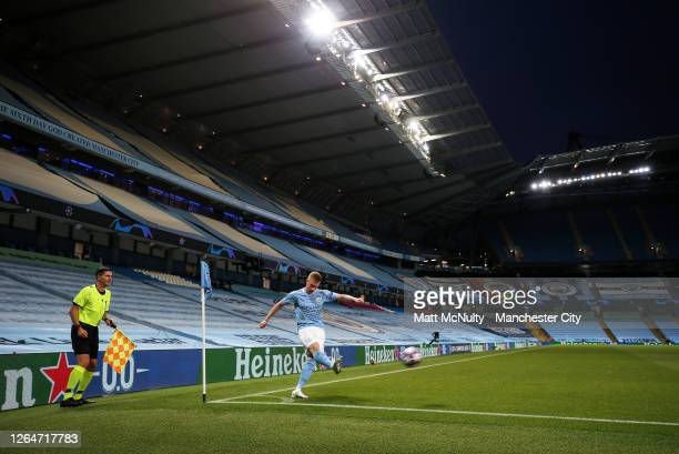 Kevin de Bruyne of Manchester City takes a corner in front of an empty stand during the UEFA Champions League round of 16 second leg match between...