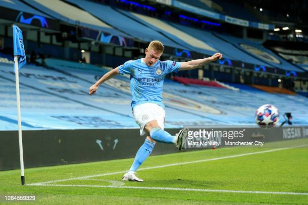 Kevin De Bruyne of Manchester City takes a corner kick during the UEFA Champions League round of 16 second leg match between Manchester City and Real...