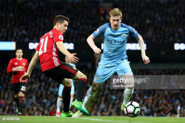 Kevin De Bruyne of Manchester City takes on Ander Herrera of Manchester United during the Premier League match between Manchester City and Manchester...