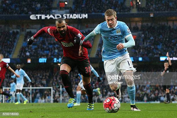 Kevin de Bruyne of Manchester City takes on Sandro of West Bromwich Albion during the Barclays Premier League match between Manchester City and West...