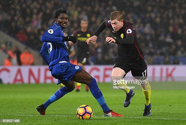 Kevin De Bruyne of Manchester City takes the ball past Daniel Amartey of Leicester City during the Premier League match between Leicester City and...