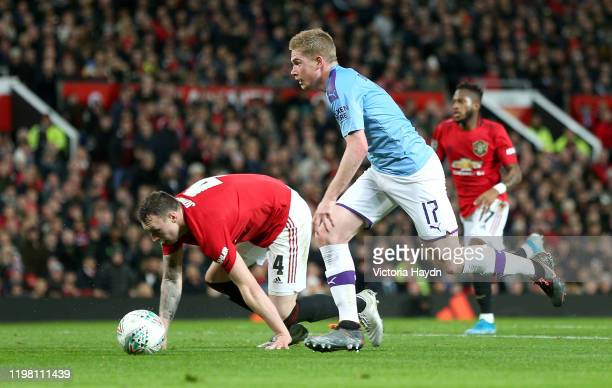 Kevin De Bruyne of Manchester City takes the ball past Phil Jones of Manchester United and goes on to score his sides third goal during the Carabao...