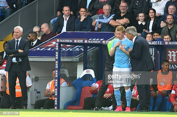 Kevin De Bruyne of Manchester City talks with Manuel Pellegrini, manager of Manchester City before coming on as a substitute during the Barclays...