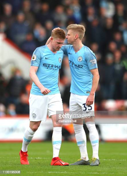 Kevin De Bruyne of Manchester City walks off injured as Oleksandr Zinchenko of Manchester City pats him on the head during the Premier League match...