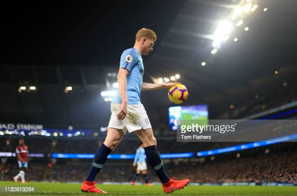 Kevin De Bruyne of Manchester City walks to the corner to take a corner kick during the Premier League match between Manchester City and West Ham...