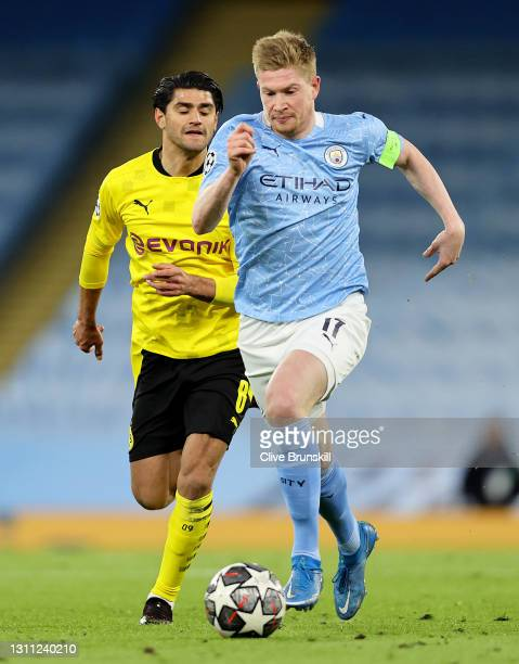 Kevin De Bruyne of Manchester Cityruns with the ball during the UEFA Champions League Quarter Final match between Manchester City and Borussia...