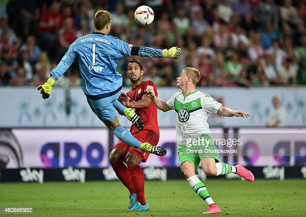 Kevin De Bruyne of VfL Wolfsburg misses a chance at goal as Manuel Neuer of FC Bayern Muenchen misses the ball during the DFL Supercup 2015 match...