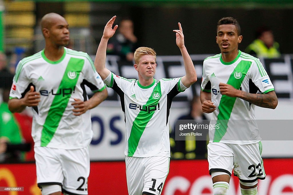 Kevin De Bruyne (C) of Wolfsburg celebrates after scoring his team's first goal during the Bundesliga match between at Volkswagen Arena on May 10, 2014 in Wolfsburg, Germany.
