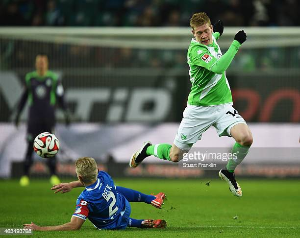 Kevin De Bruyne of Wolfsburg is challenged by Andreas Beck of Hoffenheim during the Bundesliga match between VfL Wolfsburg and 1899 Hoffenheim at...