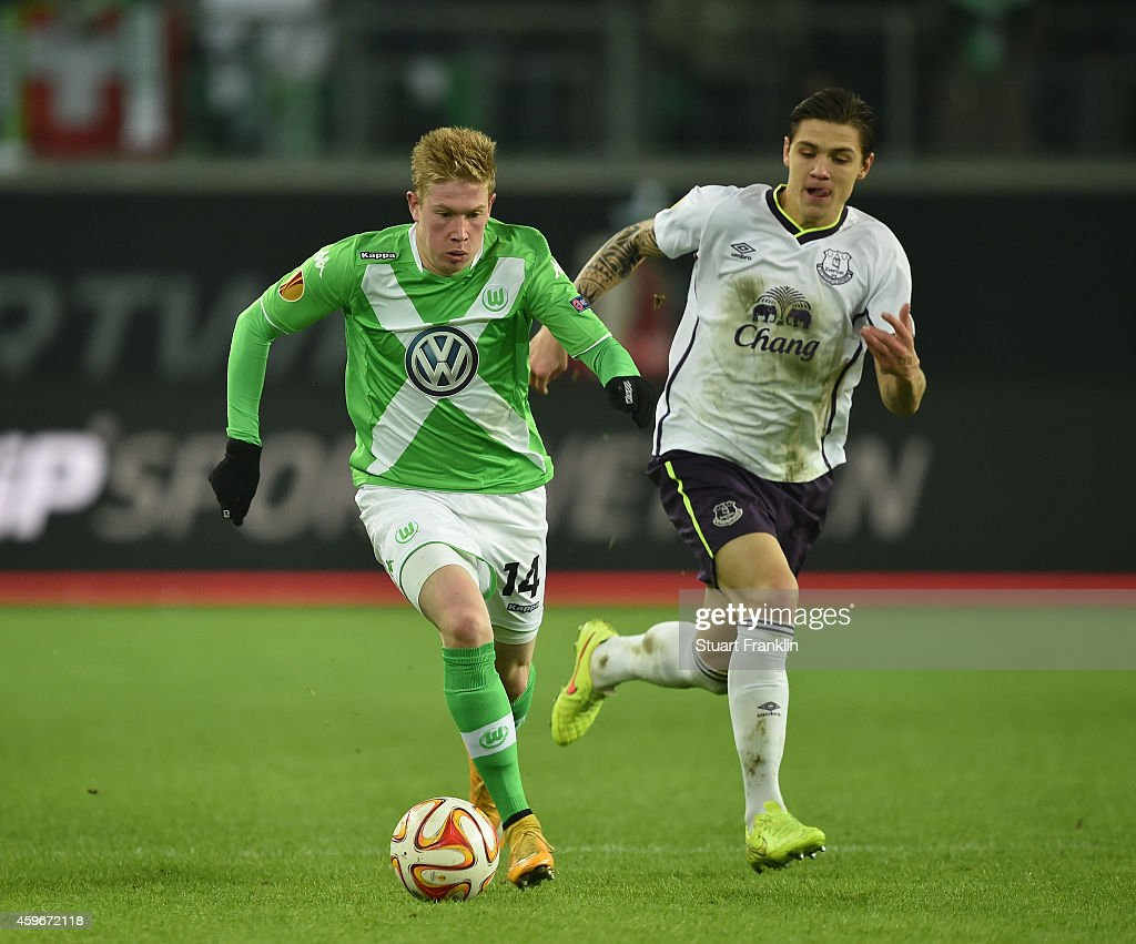 Kevin De Bruyne Of Wolfsburg Is Challenged By Muhamed