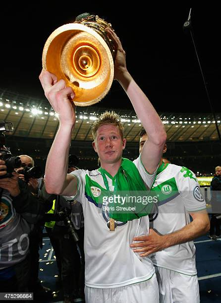 Kevin De Bruyne of Wolfsburg lifts the trophy to celebrate after winning the DFB Cup Final match between Borussia Dortmund and VfL Wolfsburg at...