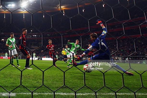 Kevin de Bruyne of Wolfsburg scores his team's first goal against goalkeeper Kevin Trapp of Frankfurt during the Bundesliga match between Eintracht...