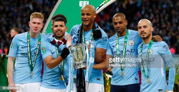 Kevin De Bruyne Sergio Aguero Vincent Kompany Fernandinho and David Silva of Manchester City celebrate after the Carabao Cup Final between Arsenal...