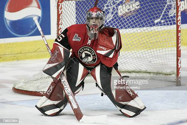 Kevin Defosses of the Quebec City Remparts watches the puck during the game against the Chicoutimi Sagueneens at Colisee Pepsi on March 16, 2007 in...