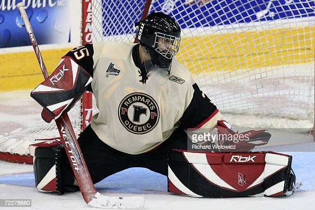 Kevin Desfosses of the Quebec City Remparts makes a glove save during the game against the Drummondville Voltigeurs on October 25, 2006 at the...
