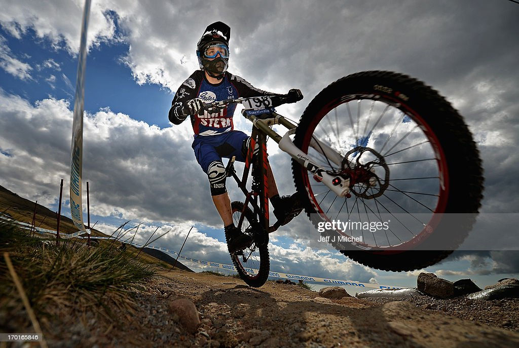 Kevin Dewinski of Germany competes in the men's downhill qualifying round at the UCI Mountain Bike World Cup on June 8, 2013 in Fort William, Scotland.