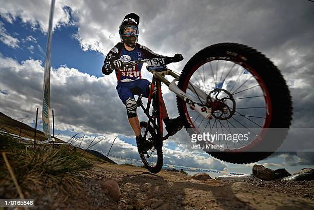 Kevin Dewinski of Germany competes in the men's downhill qualifying round at the UCI Mountain Bike World Cup on June 8 2013 in Fort William Scotland