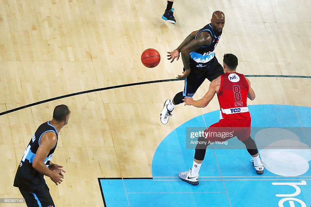 Kevin Dillard of the Breakers makes a behind-the-back pass to teammate Mika Vukona against Jarrod Kenny of the Wildcats during the round 16 NBL match between the New Zealand Breakers and the Perth Wildcats at Vector Arena on January 22, 2017 in Auckland, New Zealand.