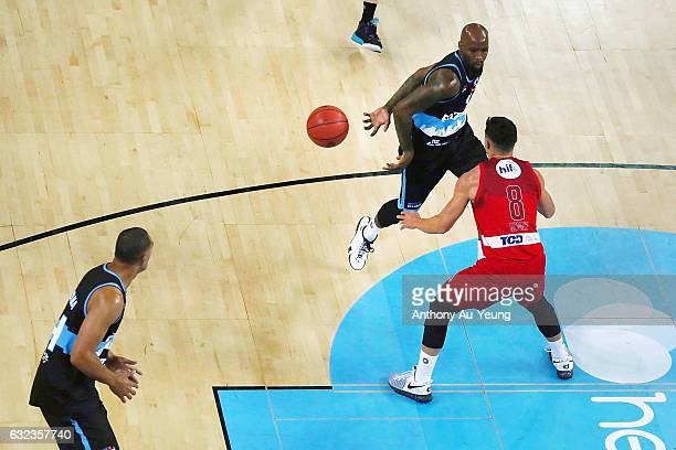 Kevin Dillard of the Breakers makes a behindtheback pass to teammate Mika Vukona against Jarrod Kenny of the Wildcats during the round 16 NBL match...