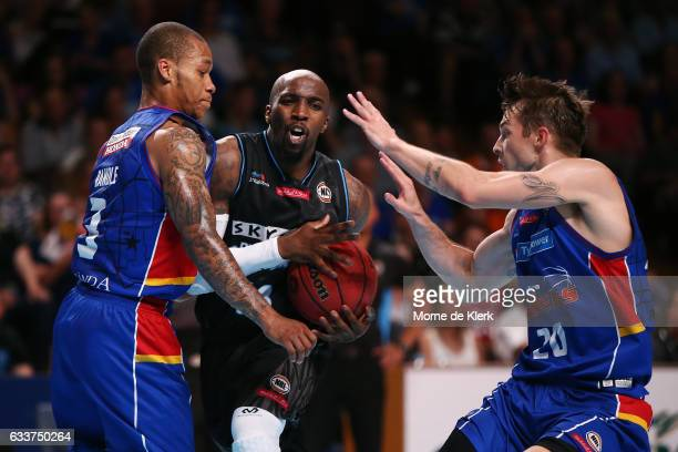 Kevin Dillard of the New Zealand Breakers competes with Jerome Randle and Nathan Sobey of the Adelaide 36ers during the round 18 NBL match between...