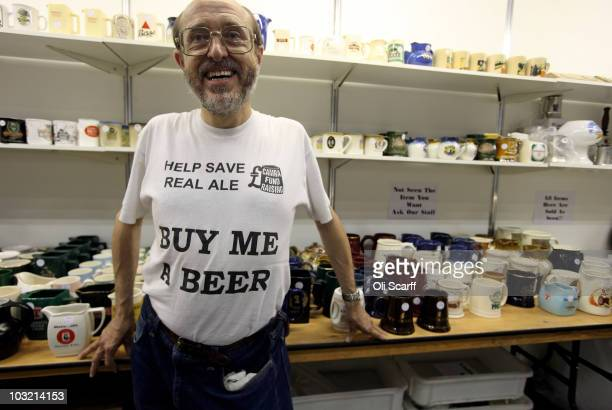 Kevin Dorrington, a CAMRA staff member, sells brewery-branded ceramics at the 'Great British Beer Festival 2010' in Earls Court exhibition centre on...