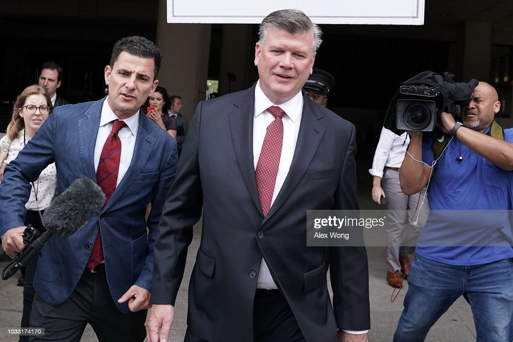 Kevin Downing (C), attorney of former Trump campaign chairman Paul Manafort, leaves U.S. District Courthouse after a pretrial hearing September 14, 2018 in Washington, DC. Manafort has pleaded guilty to two criminal charges and agreed to cooperate with special counsel Robert S. Mueller's investigation of Russian interference in the presidential election in 2016.