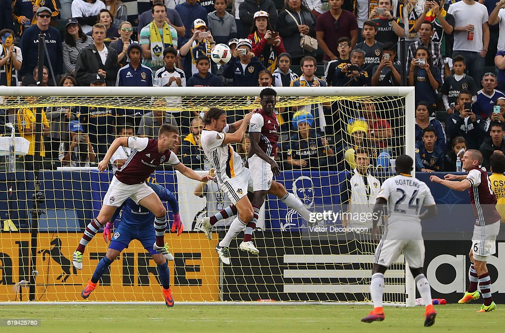 Kevin Doyle #9 and Dominique Badji #14 of Colorado Rapids and Alan Gordon #9 of Los Angeles Galaxy vie for the ball near the goal box as Ema Boateng #24 of Los Angeles Galaxy and Sam Cronin #6 of Colorado Rapids look on during the first half of leg one of the Audi 2016 MLS Cup Playoff Western Conference Semfinal between the Colorado Rapids and the Los Angeles Galaxy at StubHub Center on October 30, 2016 in Carson, California. The Galaxy defeated the Rapids 1-0 in leg one of the two game playoff Western Conference Semifinal series.