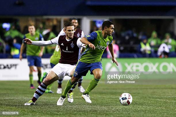 Kevin Doyle of Colorados Rapids and Cristian Roldan of Seattle Sounders FC during the first leg of the Western Conference Championship in the Audi...
