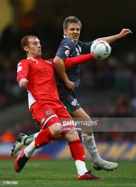 Kevin Doyle of Ireland battles with James Collins of Wales during the Euro2008 Qualifier match between Wales and Republic of Ireland at the...